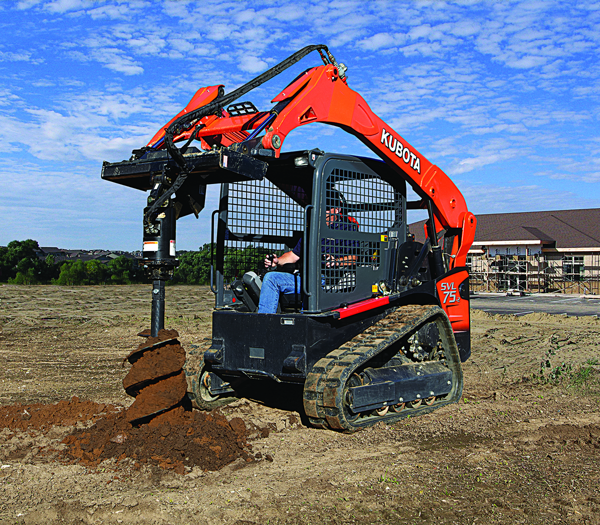 Kubota compact track loader with auger attachment