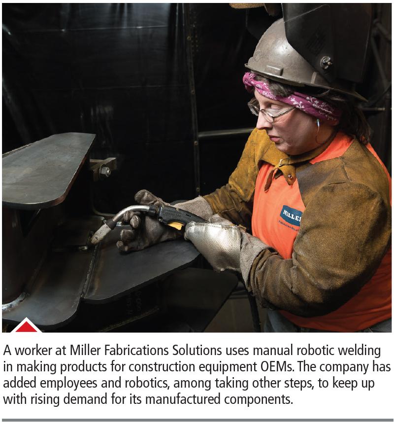Miller Fabrications Solutions employee using manual robotic welding