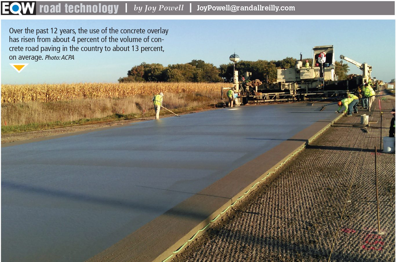 Construction crew pouring concrete overlay on road