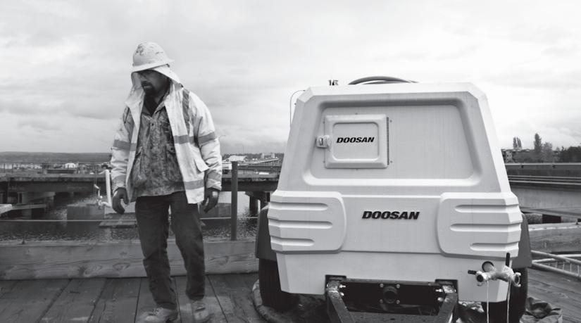 Construction worker with Doosan equipment