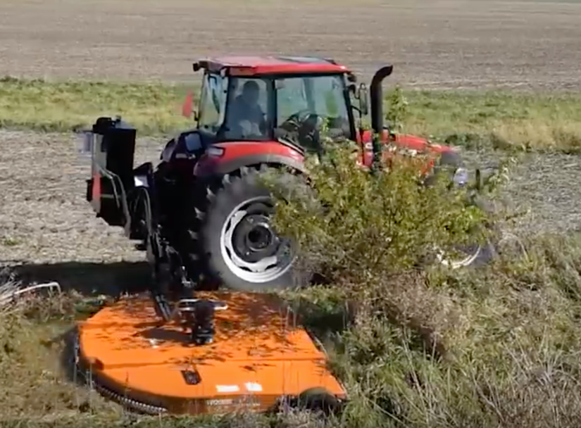 Woods' new Ditch Bank Rotary Cutters attached to tractor