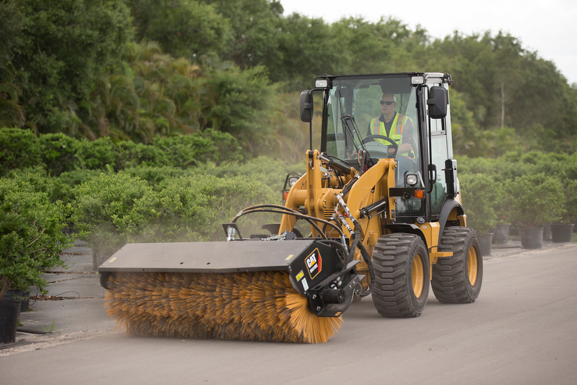 CAT 903D with angle broom attachment