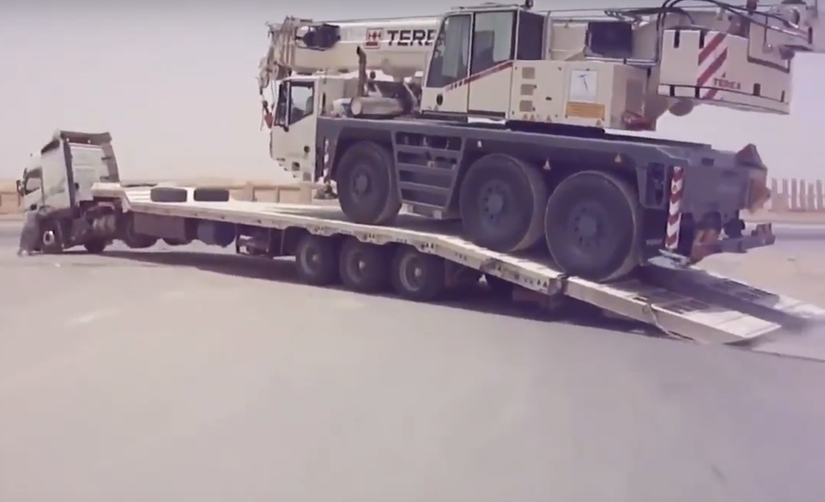 Terex crane being loaded onto a trailer
