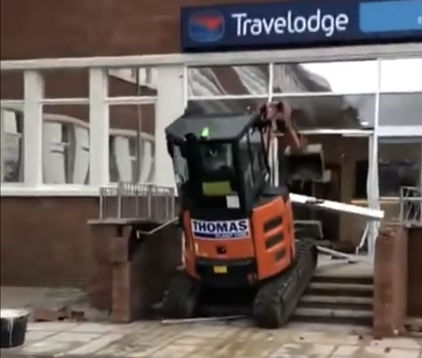 Excavator in the window of the Travelodge