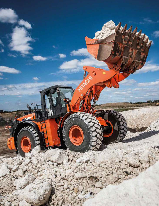 Hitachi ZW550-6 wheel loader carrying boulders