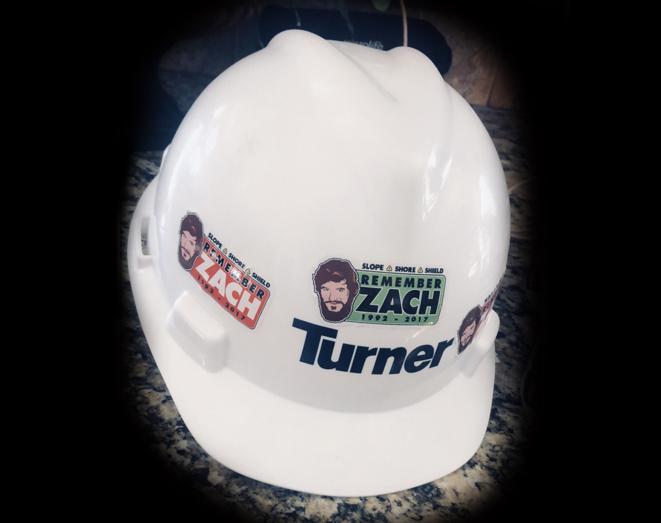 """Remember Zach"" Stickers on Hard Hat"