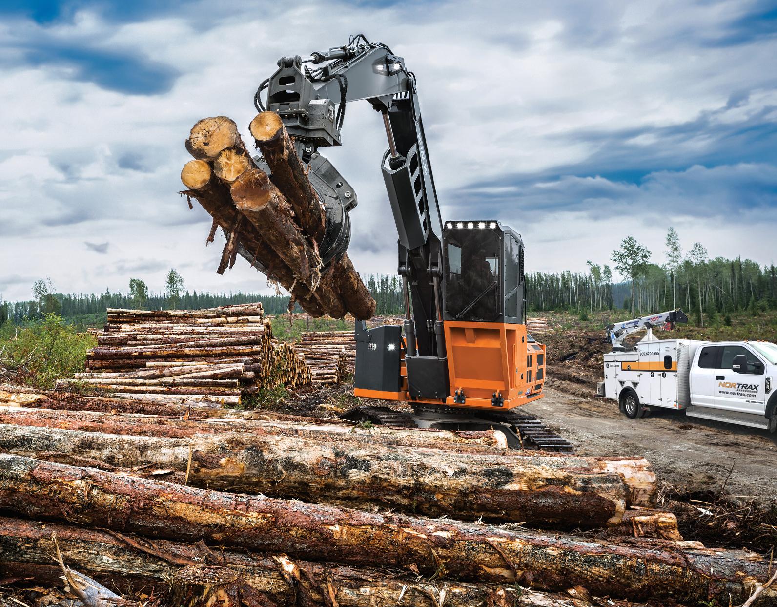 Hitachi forestry charlotte nc dump trucks picking up logs