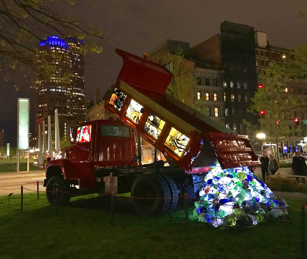 Red dump truck on display as public art with stained glass