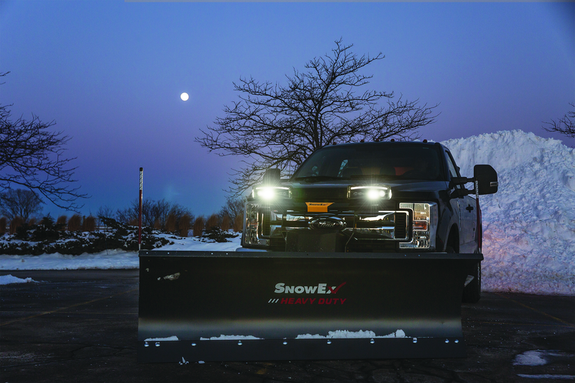 Truck with SnowEx plow and headlights