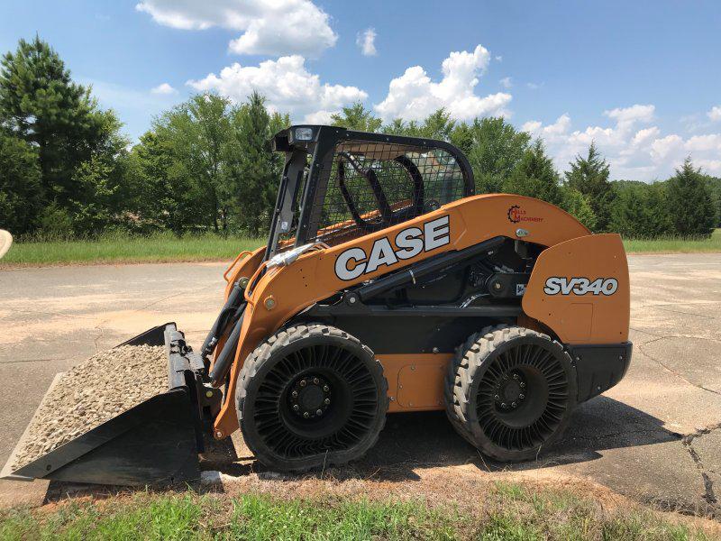 case SV340 skid steer with bucket full of gravel