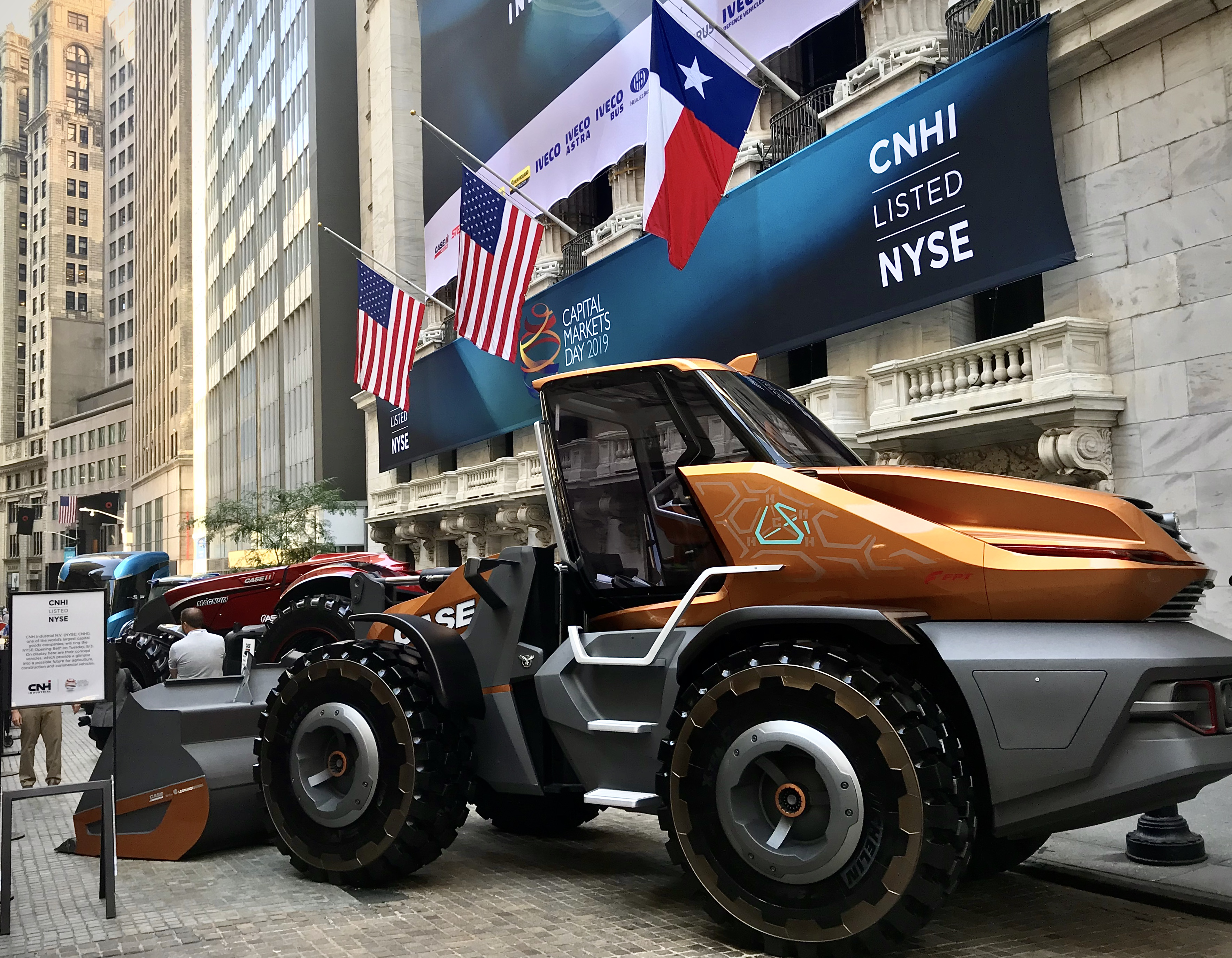 CNH Industrial listed on NYSE banner and Case CE's Tetra concept loader outside of the New York Stock Exchange on Wall Street