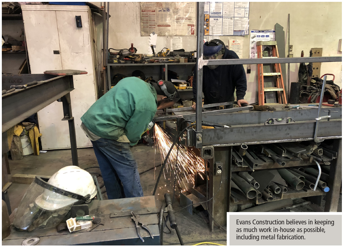 two metal fabrication technicians at Evans construction