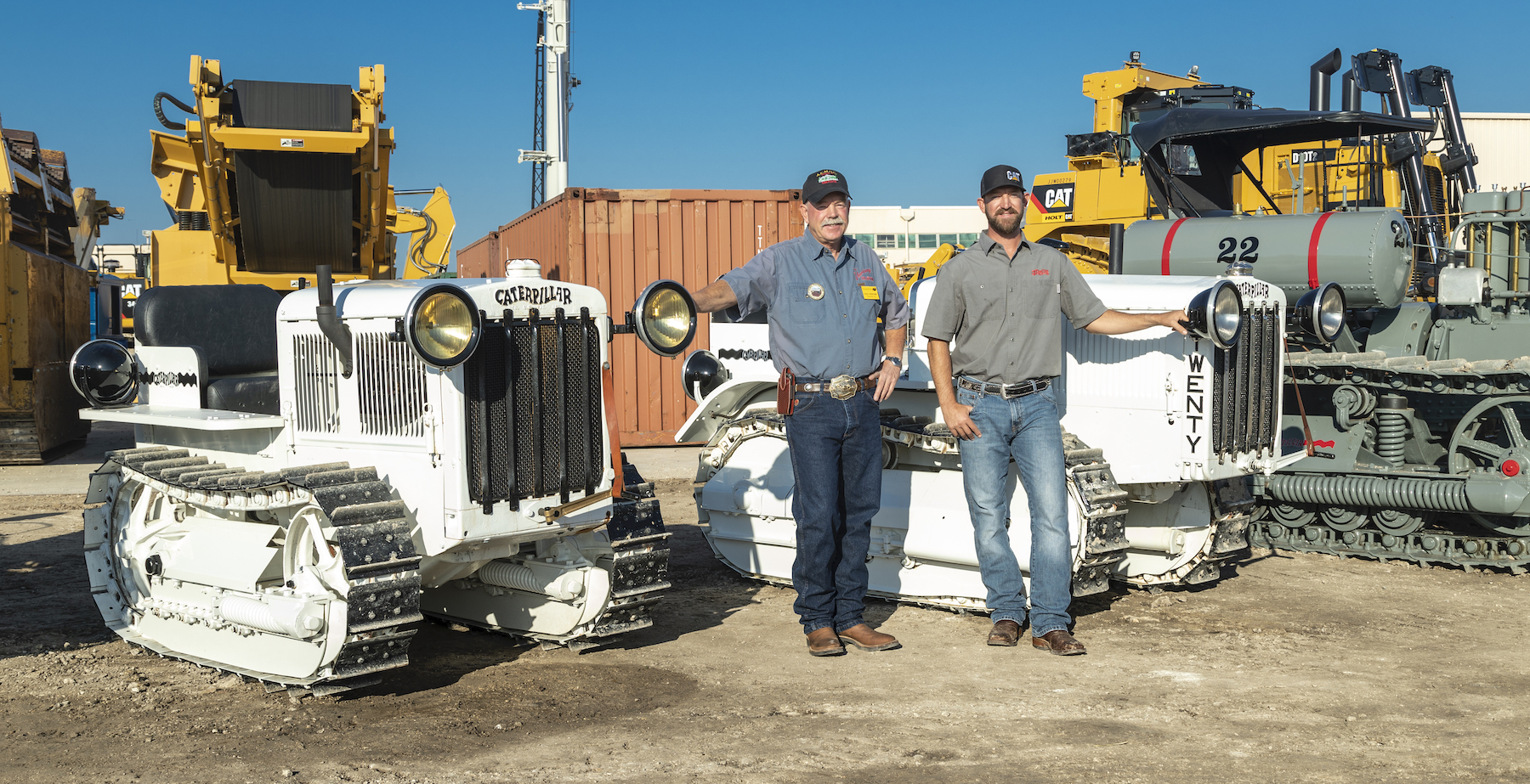 Doug and Matt Veerkamp with restored Caterpillar tractors