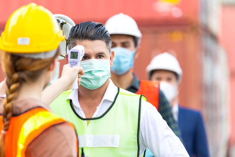 construction worker's temperature being taken at jobsite
