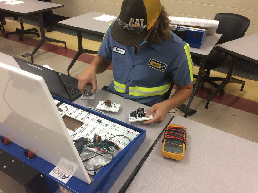 diesel tech working with parts at Florence-Darlington Technical Community College