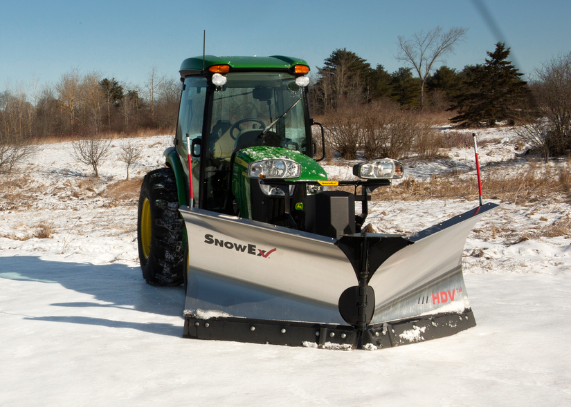 SnowEx Automatixx attachment kit with snowplow on tractor