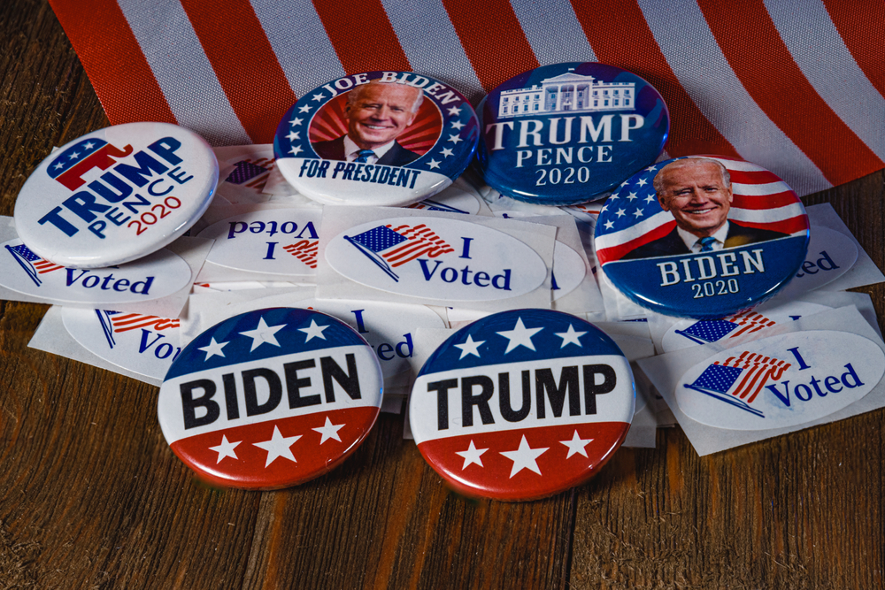 biden and trump presidential election pins with 'I voted' stickers