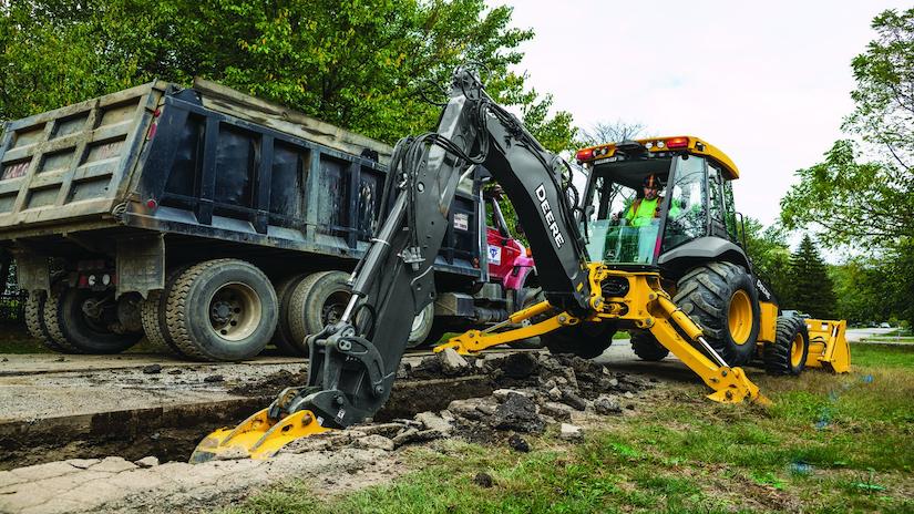 John Deere L-Series Backhoe digging trench