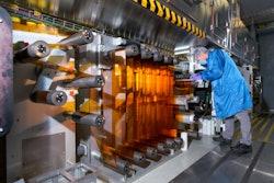 General Motors Fuel Cell Controls and Process Engineer Joe Truchan operating a coating machine