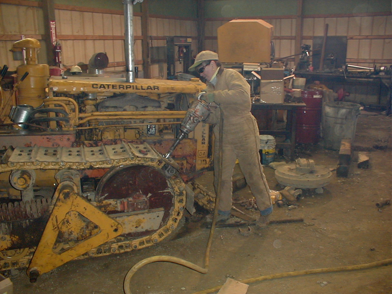 Nancy McDonnell works on restoring her 1956 Cat D4.