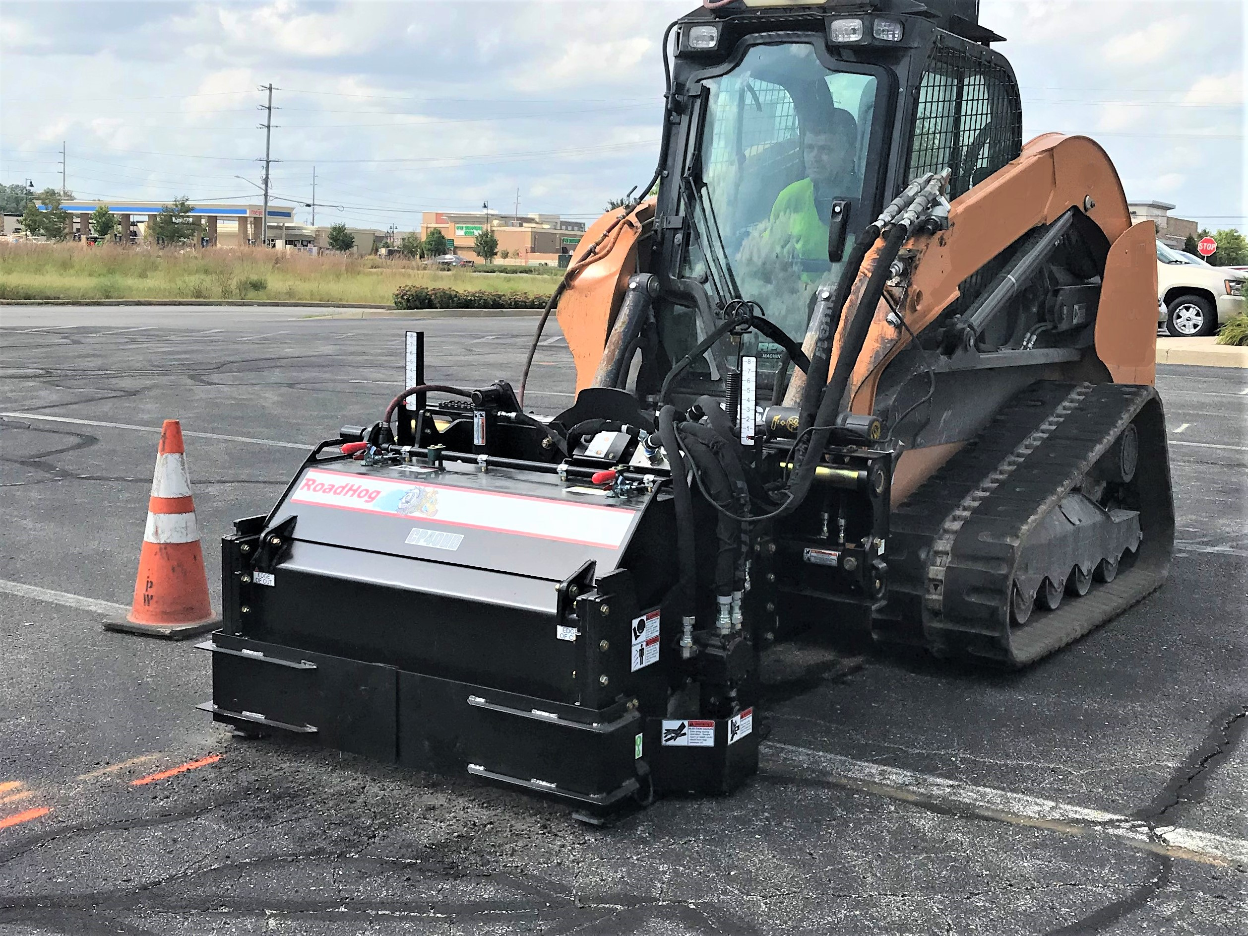 RoadHog's G5HD skid steer cold planer attached to a skid steer