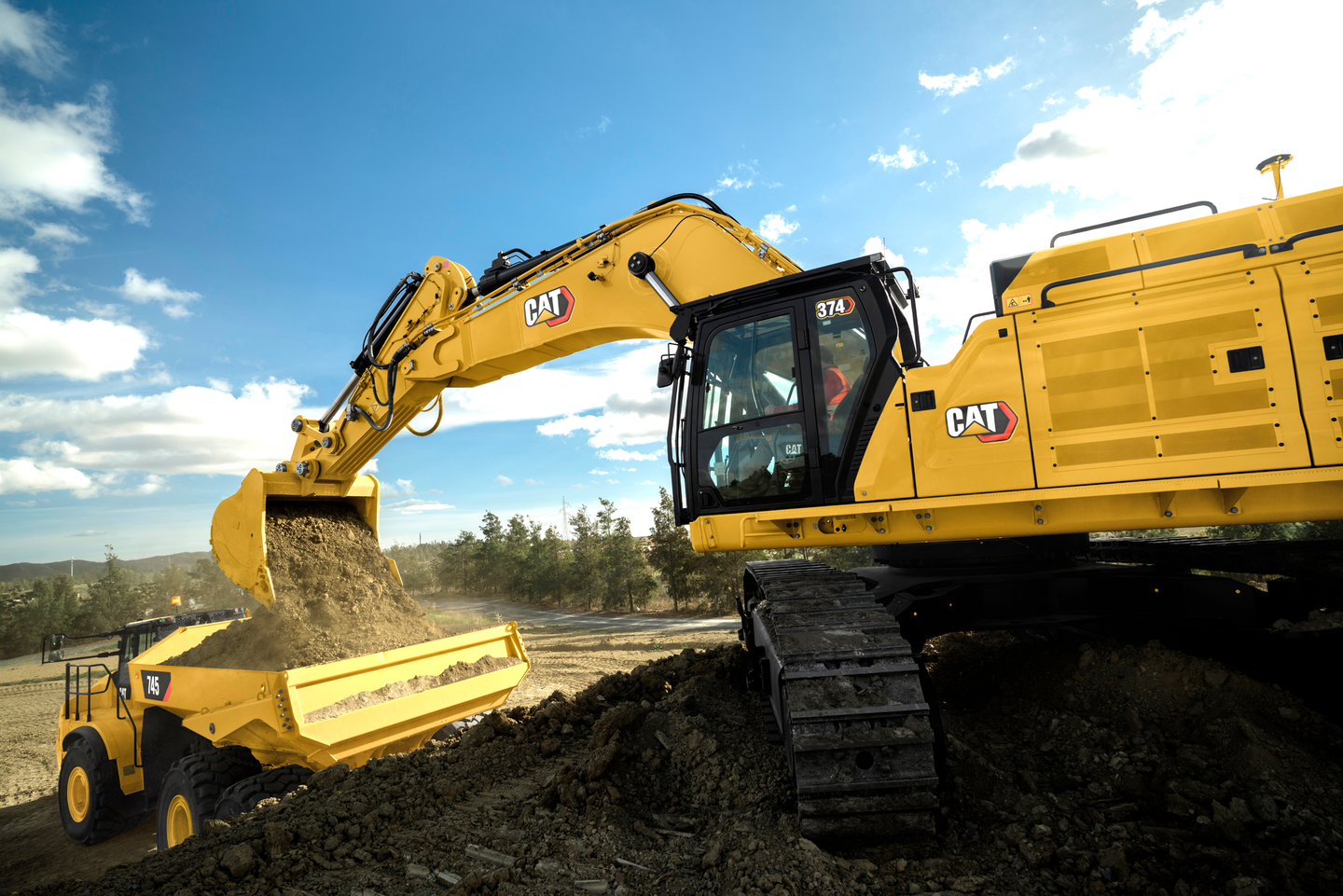 The Cat 374 cab has a Bluetooth-integrated radio and USB ports for phone charging.
