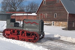 Holt Caterpillar 10-Ton tractor surrounded by snow in front of barn in St. Stephen, Minnesota