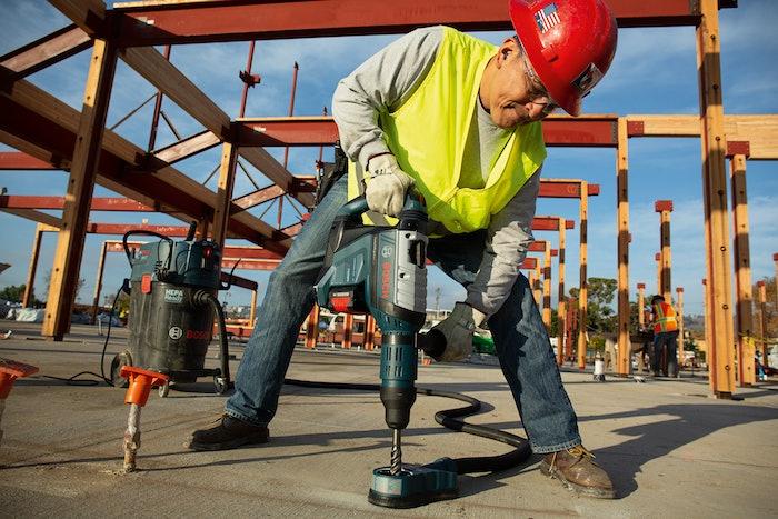 Worker using Bosch ProFactor rotary hammer