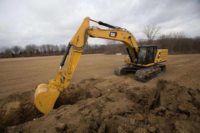 Cat 336 excavator digging trench