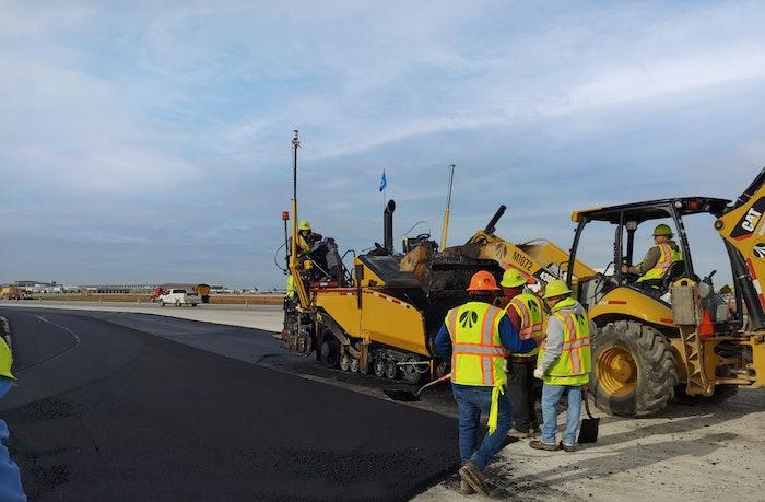 Workers paving asphalt