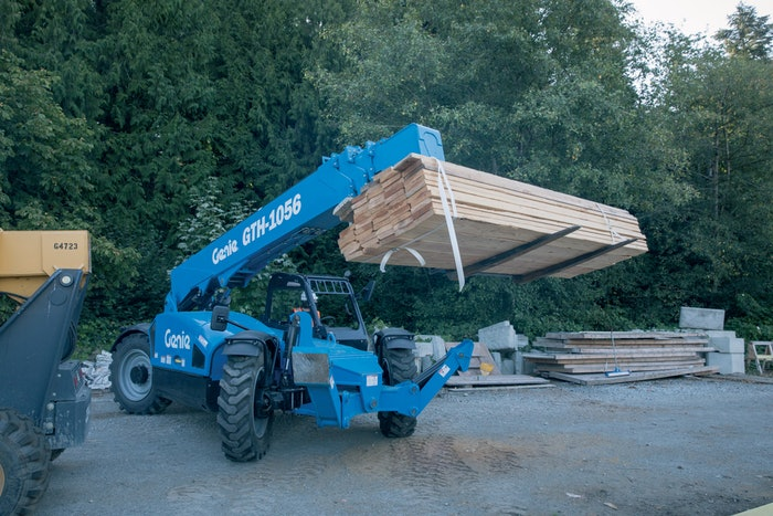 Genie GTH-1056 telehandler moving lumber
