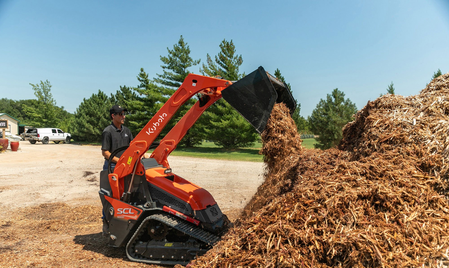 Kubota incorporated many design elements of its compact track loaders in developing its first CUL, the SCL1000. Controls are pilot operated. Standard features include keyless start with passcode protection, 12-volt charging port and a 4.3-inch LCD color dash monitor. Push-button control of auxiliary hydraulics is built into the loader control handle. Cushioned loader boom cylinders and an adjustable platform suspension system enhance operator comfort.