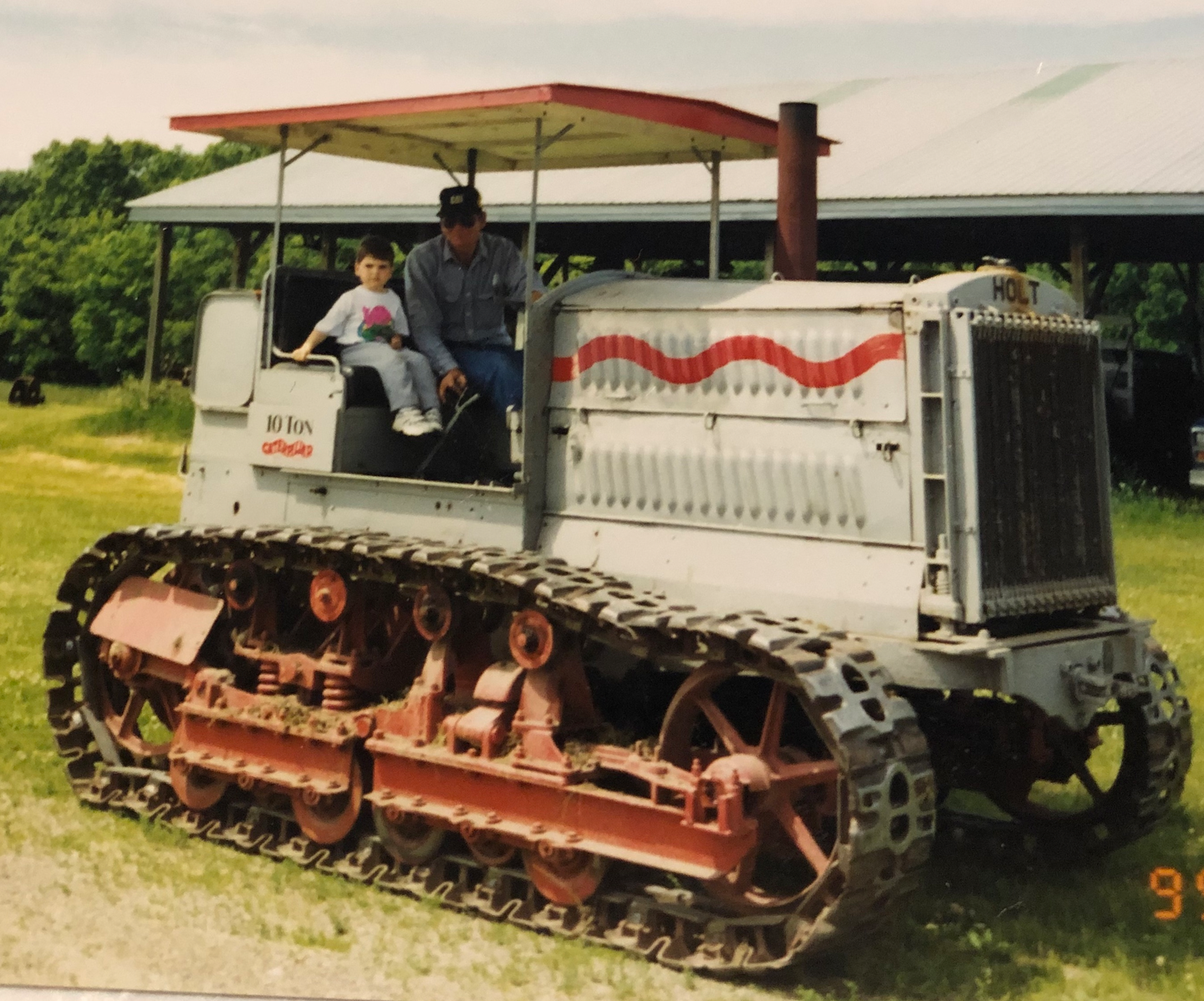 Scott Vouk at age 4 gets a ride on the Holt Caterpillar 10-Ton.