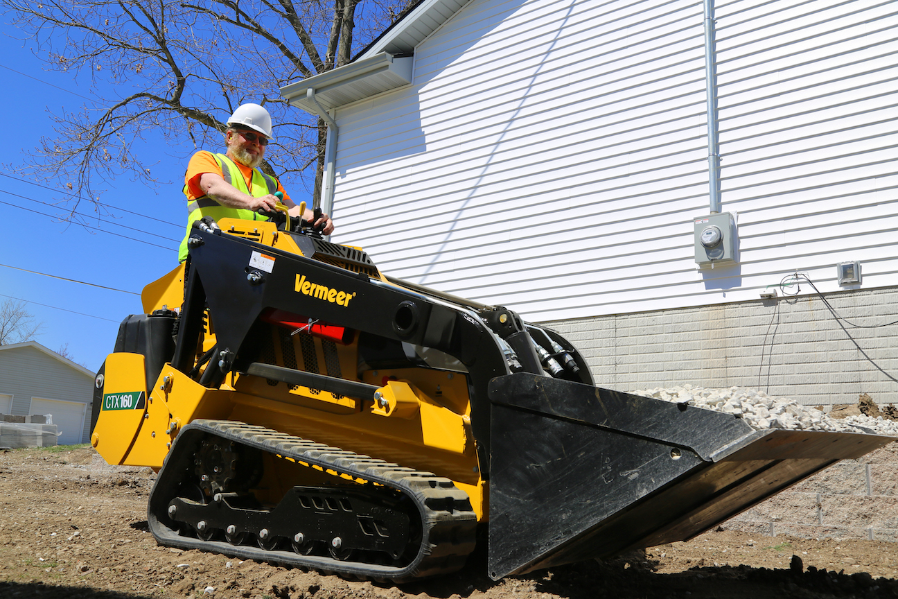 The Vermeer CTX160 is powered by a Kohler diesel engine rated at 40 horsepower. The dual hydraulic system provides up to 16.7 gpm of auxiliary flow at 3,045 psi of pressure. Operating weight with the standard bucket is 4,120 pounds, and rated lift capacity is 1,600 pounds. Hinge pin height is 88.8 inches. Machine dimensions are 59 inches high, 42 inches wide (with 9-inch tracks) and 116 inches long (with the standard bucket).