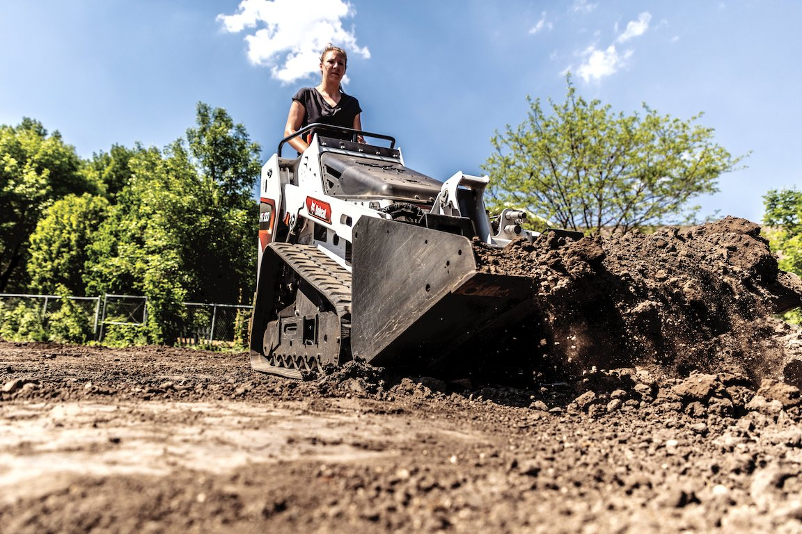 The Bobcat MT100 has an operating weight of 3,390 pounds. Standard equipment includes removeable counterweights that can be mounted to either the undercarriage or the rear uprights to increase lifting performance. Hydraulic pressure is 2,900 psi. Width is 36 inches with narrow tracks and 41 inches with optional wide tracks. Height is 54.6 inches.