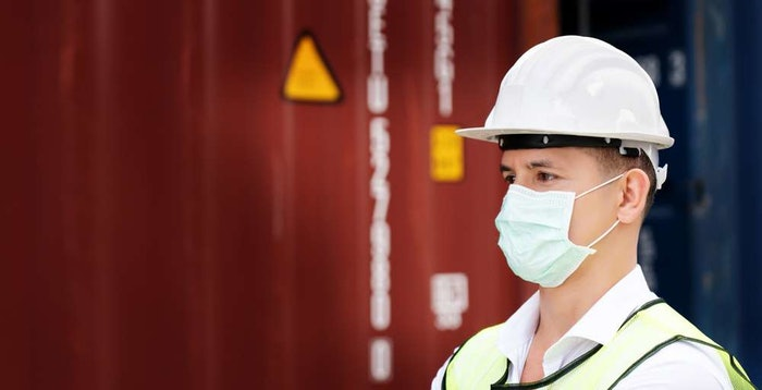 construction worker wearing hard hat and safety vest