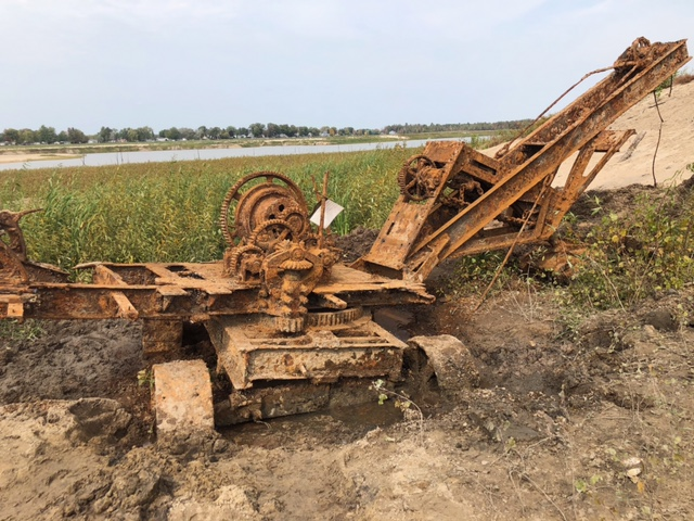 A view of the old shovel at the emptied Wixom Lake after zebra mussels have been removed along with the boiler and water tank.