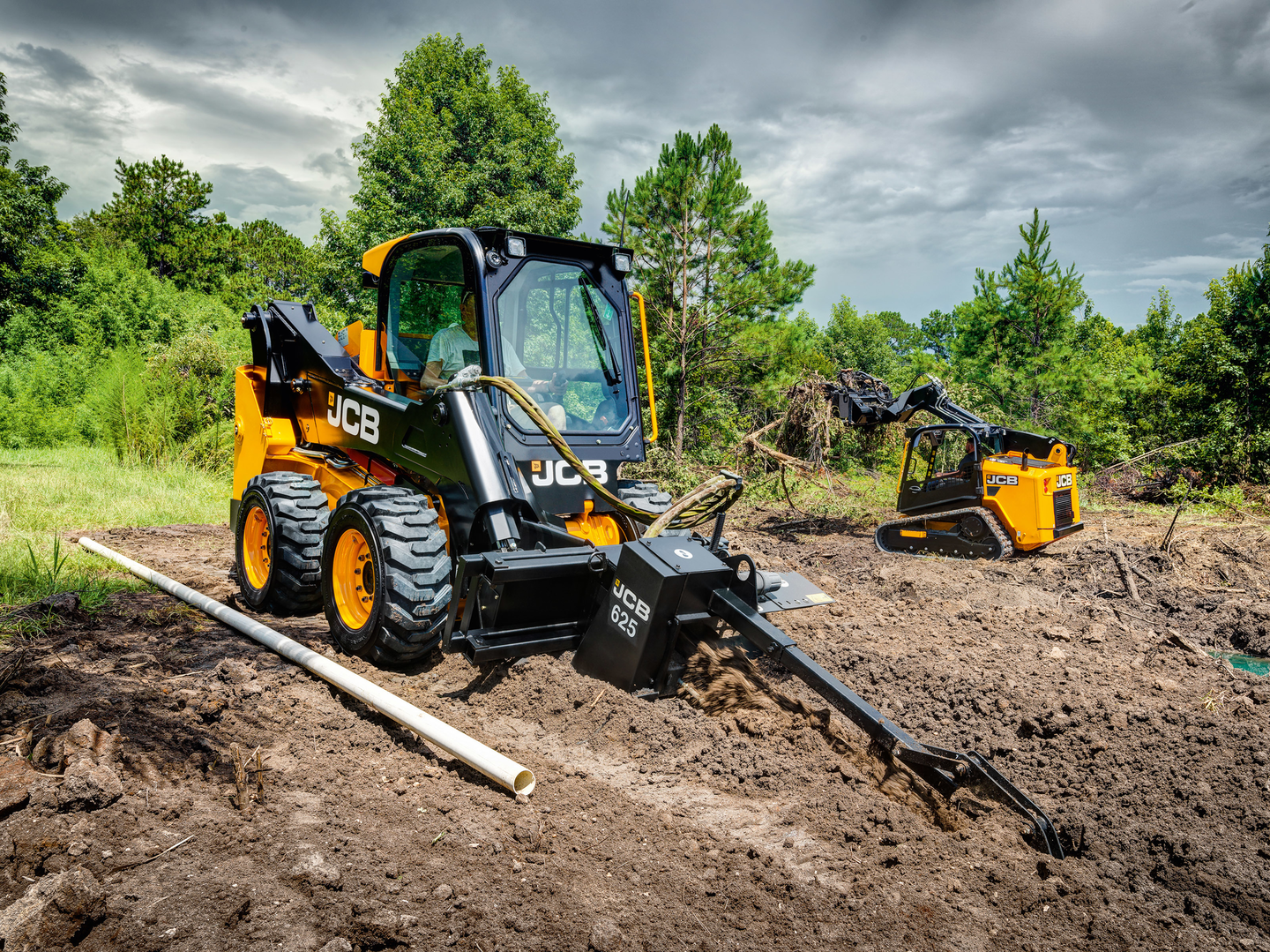JCB skid steer with 625 trencher attachment