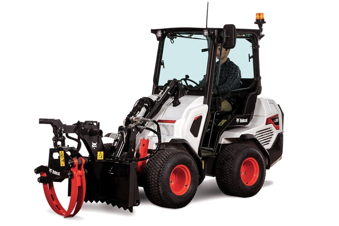 bobcat small articulated loader with log grapple