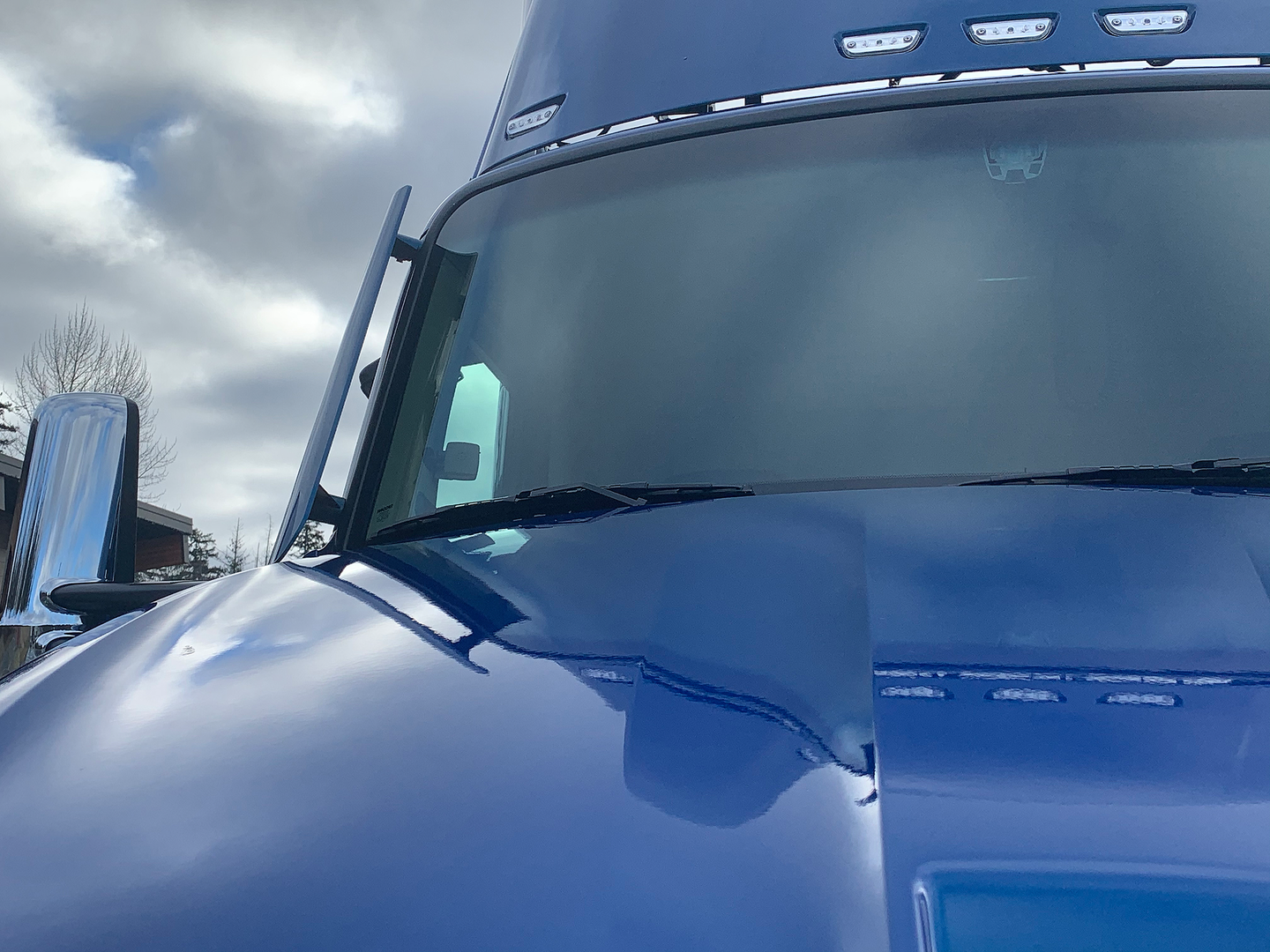 A-pillar mounted turning vanes reduce drag by keeping air along the side of the truck and trailer.