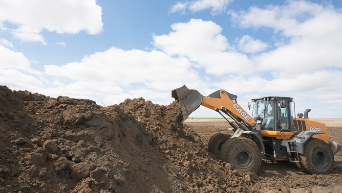 case wheel loader dumping dirt