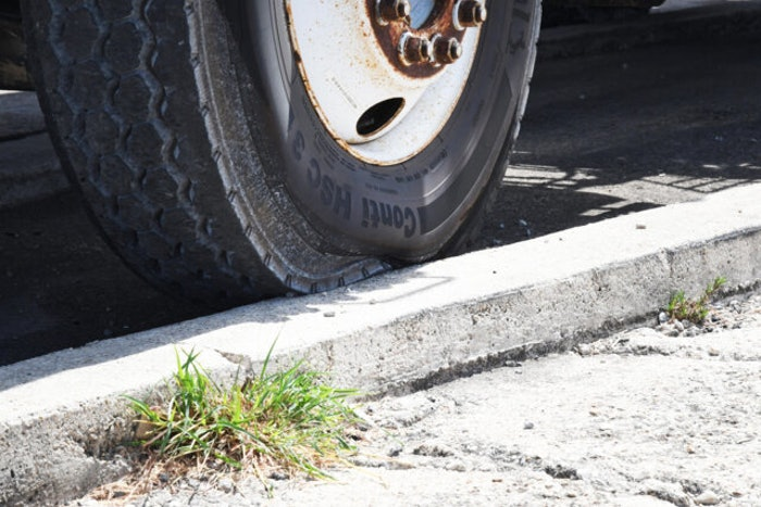 tire hitting the curb