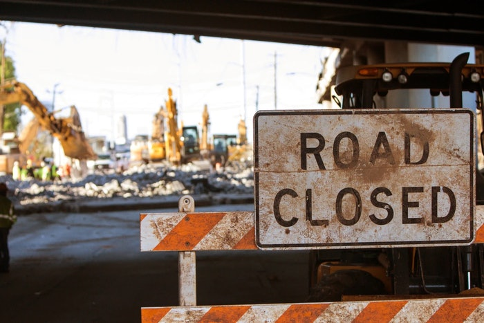 Road closed sign on construction site