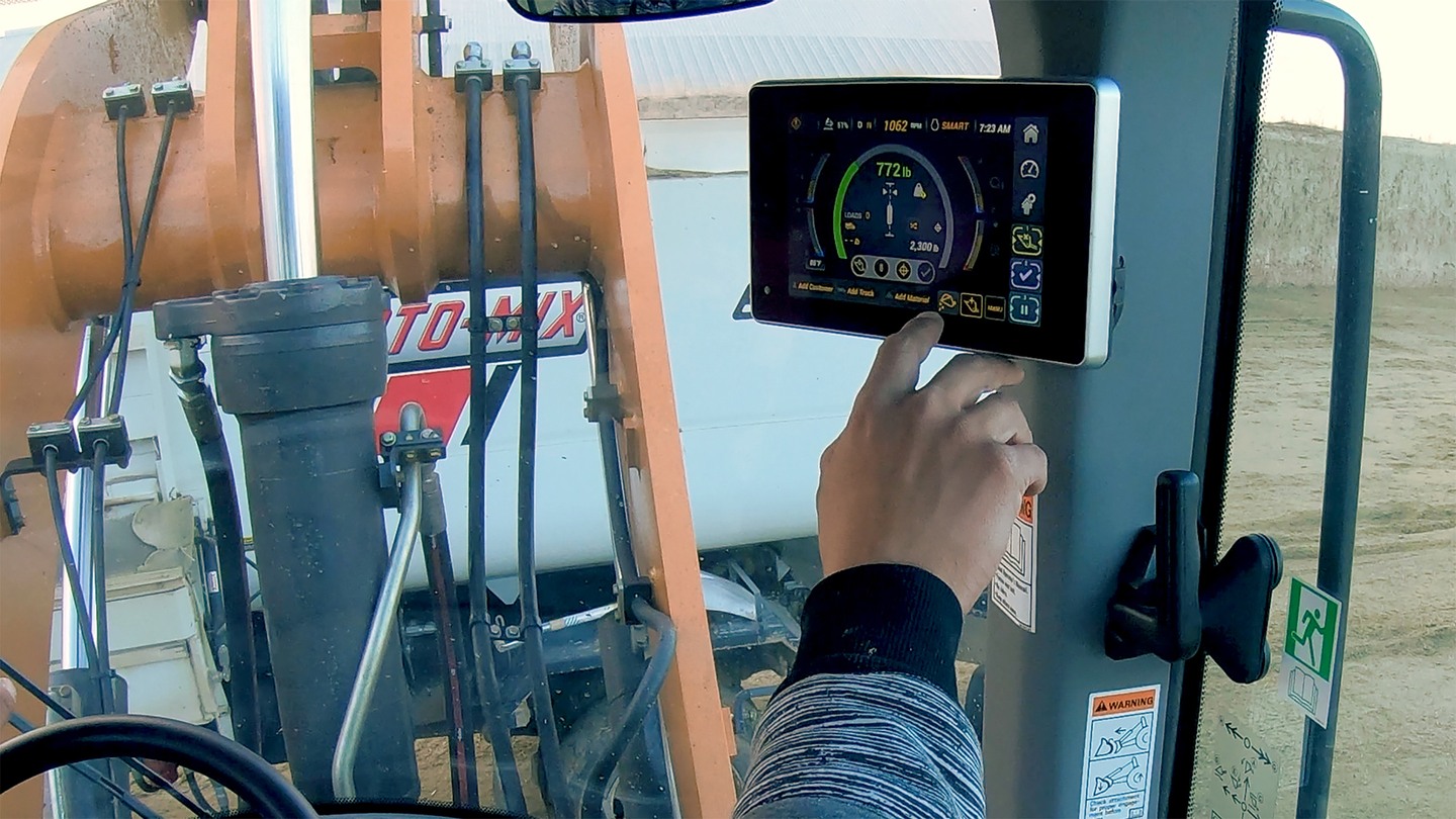 hand touching payload system inside case wheel loader