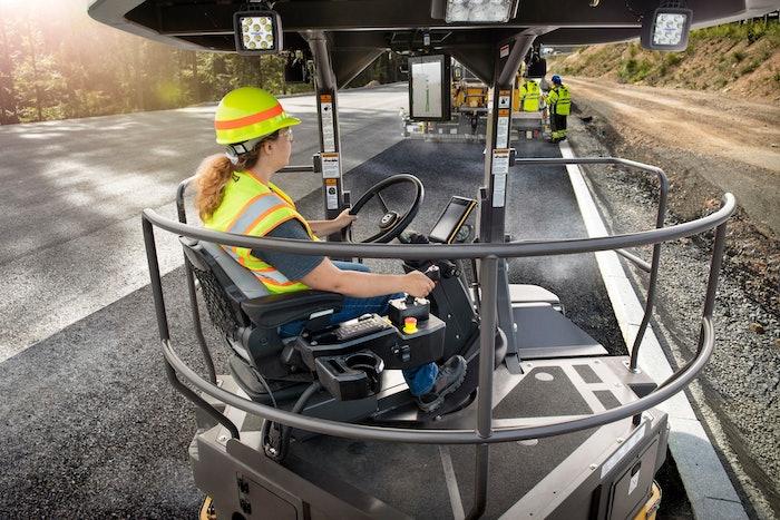 woman operating asphalt equipment