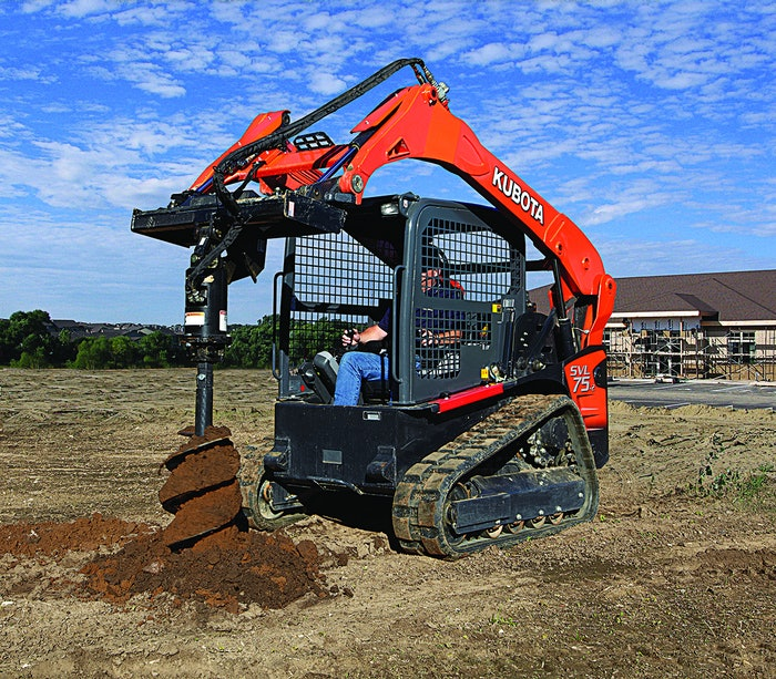 man operating kubota equipment with auger attachment