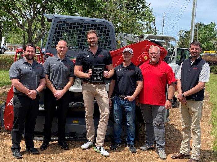 Cobb County Tractor company photo receiving Takeuchi dealer award