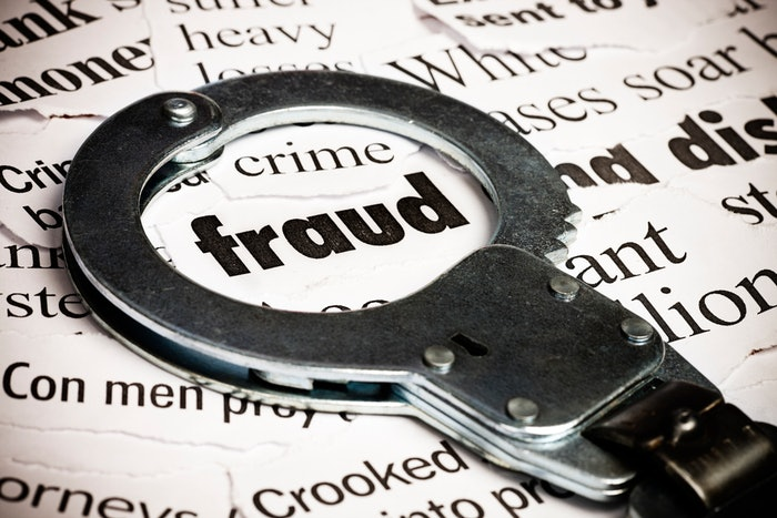 handcuff over the word fraud
