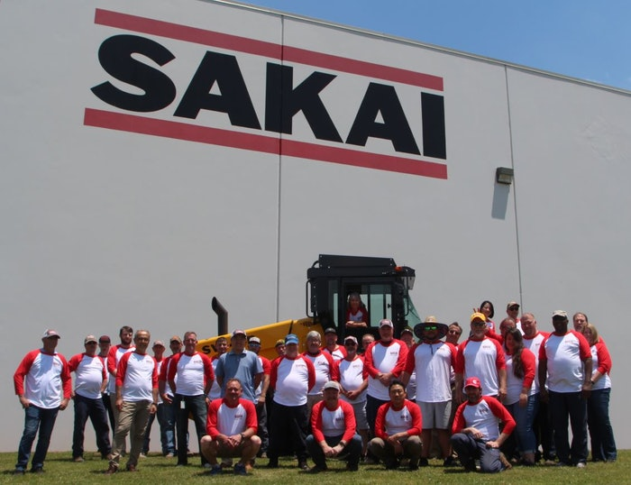 sakai workers having picture taken outside facility