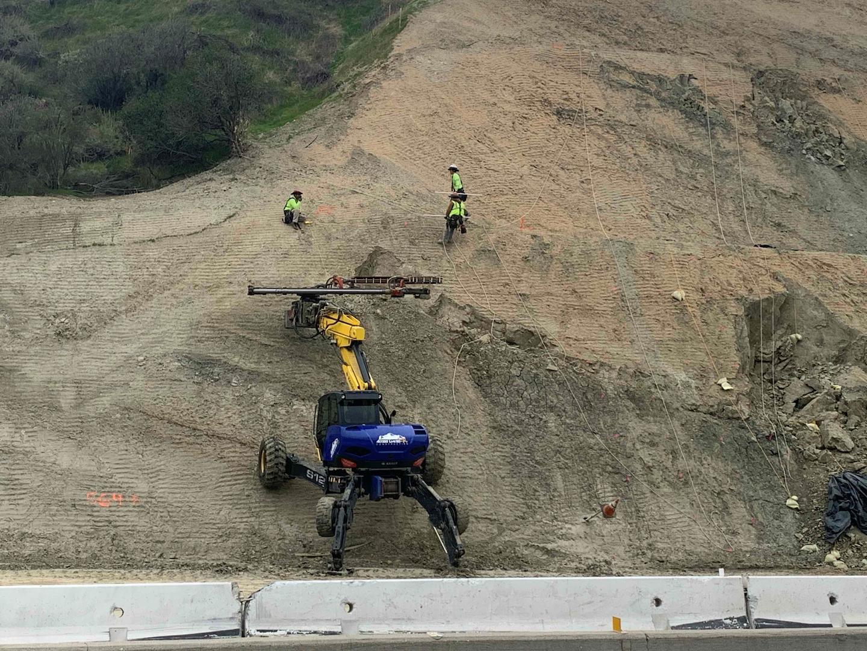 spider excavator at work on steep hill